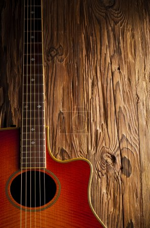 Country guitar on wood