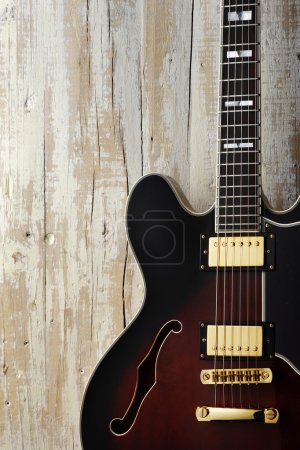 Photo for Electric guitar on aged white wood - Royalty Free Image