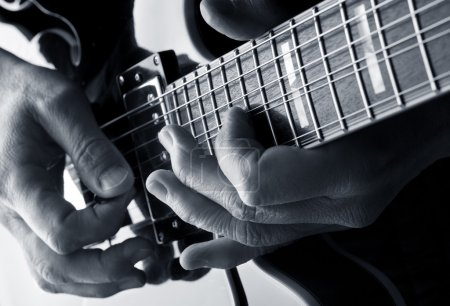 Photo for Playing notes on a blues guitar - Royalty Free Image
