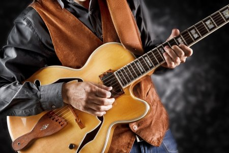 Photo for Jazz guitarist playing a custom guitar - Royalty Free Image