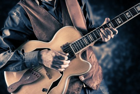 Photo for Guitar player, vintage style filterd image - Royalty Free Image