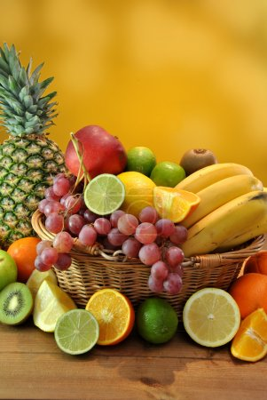 Photo for Wooden basket filled with healthy and fresh fruits - Royalty Free Image