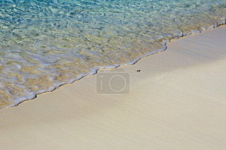 Photo for Nice blue water ripples near a shore in the Indian Ocean - Royalty Free Image
