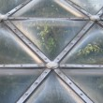 Постер, плакат: Bubbly Greenhouse Dome Windows