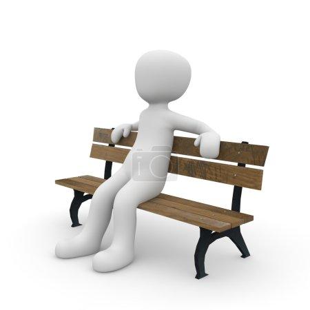 Photo pour Un personnage est assis confortablement sur un banc de parc . - image libre de droit