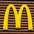 Mc Donald's Logo on a wooden background from the m...
