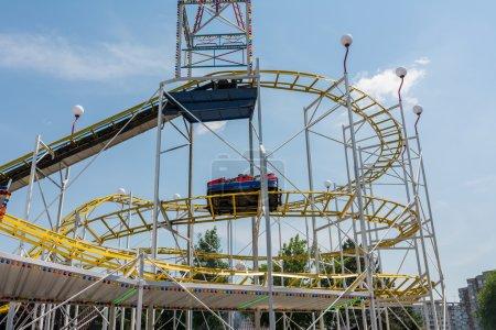 Children Having Fun In Roller Coaster