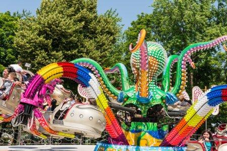 Children Having Fun In Octopus Ride