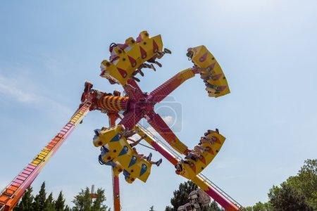 People Having Fun In Amusement Park