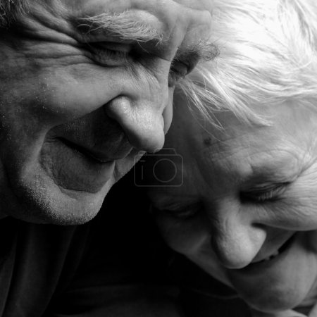 Photo for A loving, handsome senior couple on a black background. - Royalty Free Image