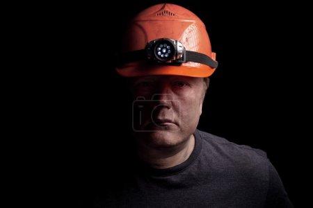 Coal miner on a black background...
