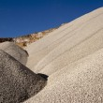 Heaps of aggregate in a rock quarry near Split in ...