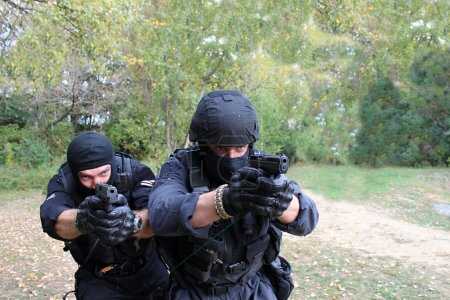 masked policeman shoots