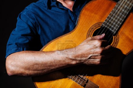 Photo for A human hand foreground playing the guitar - Royalty Free Image