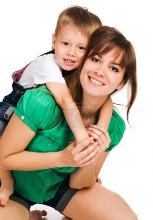 Beautiful mom giving her son a piggyback ride