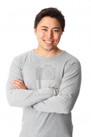 Photo pour Jeune homme beau debout portant une chemise grise. Fond blanc . - image libre de droit