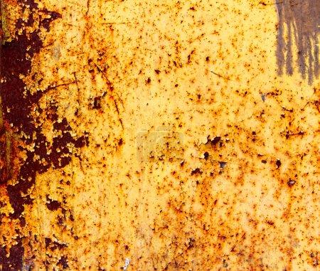 Bright orange yellow painted rusty metal