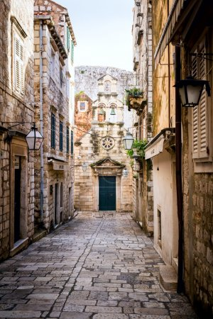 Photo for Narrow street inside Dubrovnik old town with church on the end. - Royalty Free Image