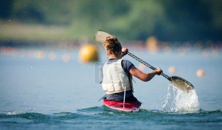 Woman Paddling Kayak in Lake