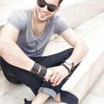 Handsome male fashion model smiling, dressed casua...