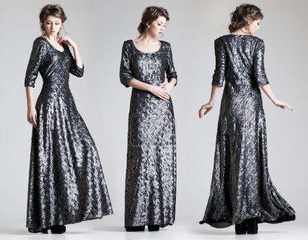 Photo for Beautiful woman model posing in elegant dress in the studio - Royalty Free Image