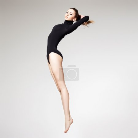 beautiful woman with perfect slim body and long legs jumping - f