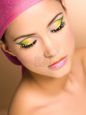 Close-up portrait of beautiful young woman wearing make-up