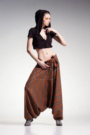 sexy woman model posing in large (salwar) pants - studio fashion shot