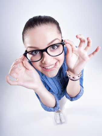 Pretty girl with perfect teeth wearing geek glasses smiling