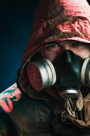 A man in a gas mask on a black background