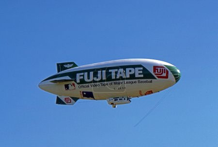 SOLBERG AIRPORT-READINGTON, NEW JERSEY, USA-JULY 17: The Fuji Blimp, advertising symbol of the Fuji Corporation, is seen flying over the 1987 New Jersey Festival of Hot Air Ballooning.