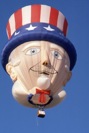 SOLBERG AIRPORT-READINGTON, NEW JERSEY, USA-JULY 17: The colorful Uncle Sam special shape hot air balloon flies high above the 1987 New Jersey Festival of Hot Air Ballooning.