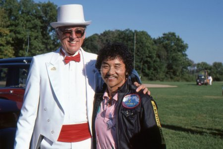 BRANCHBURG, NEW JERSEY, USA-SEPTEMBER 13: Well known balloonist and adventurer, Rocky Aoki (right), founder of Benihana restaurants, is pictured at the 1986 Somerset County Hot Air Balloon Festival.