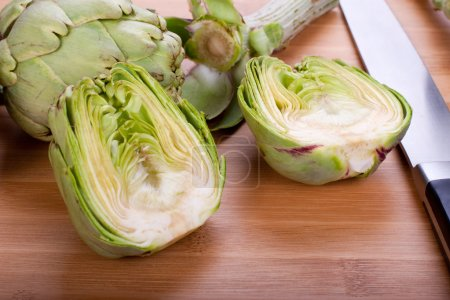 Artichokes hearts on a cutting board