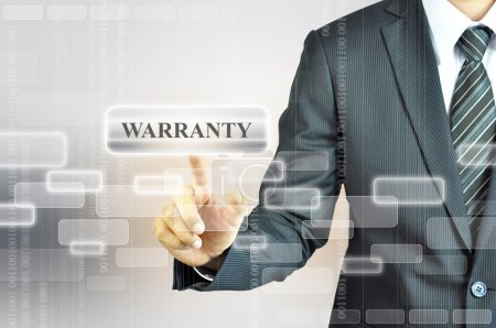 Businessman touching WARRANTY sign