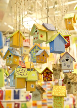 many wooden birdhouses