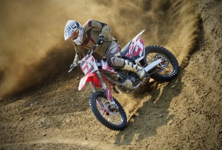 Motocross rider racing on a track in the race...
