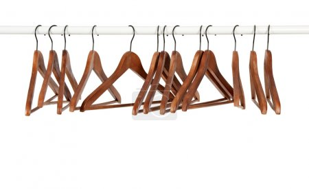 Photo for Many wooden hangers on a rod, isolated on white background. - Royalty Free Image