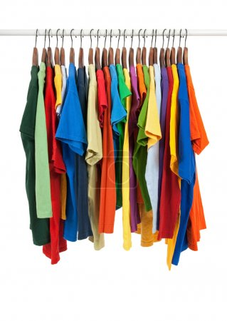 Photo for Variety of multicolored casual shirts on wooden hangers, isolated on white. - Royalty Free Image
