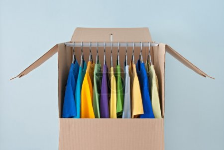 Bright clothing in a wardrobe box for easy moving