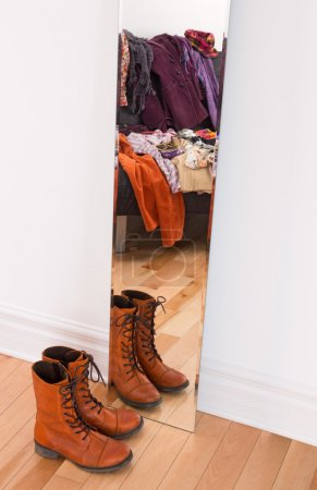 Clothes and shoes reflecting in the mirror