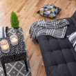Detail of a bright modern living room with gray so...