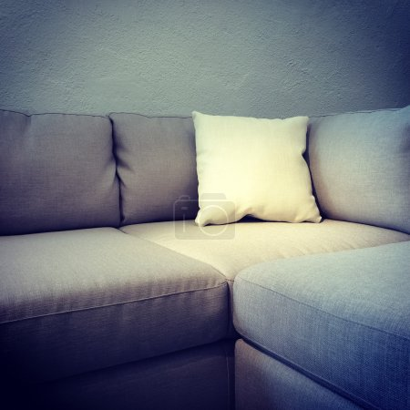 Corner sofa with white cushion