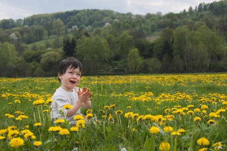 Child on spring meadow