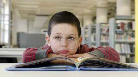 Child reading and daydreaming.