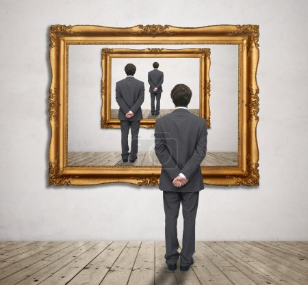 Photo for Businessman looking into an image of yourself - Royalty Free Image
