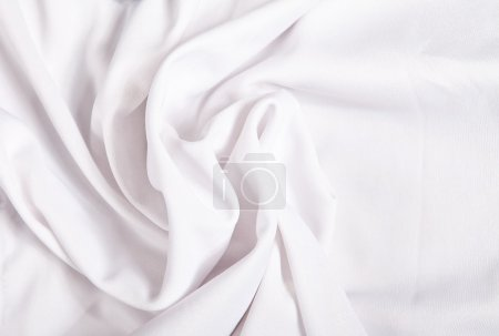 White textile background with folds