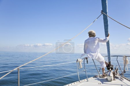 Senior Woman on the Bow of a Sail Boat