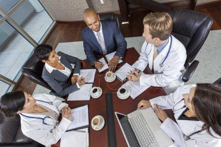 Interracial Medical Business Team Meeting in Boardroom