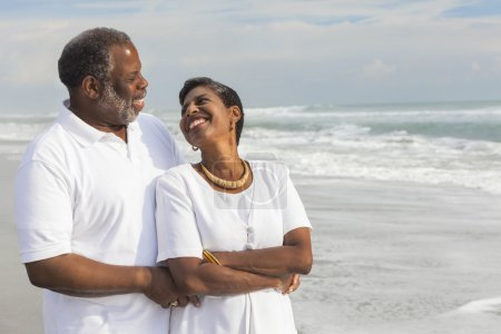 Photo for Happy romantic senior African American man and woman couple on a deserted tropical beach - Royalty Free Image